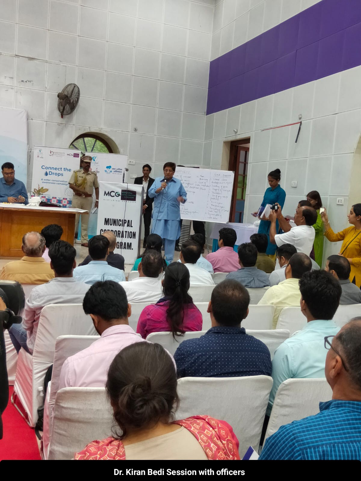 """<span  class=""""uc_style_uc_tiles_grid_image_elementor_uc_items_attribute_title"""" style=""""color:#ffffff;"""">Dr. Kiran Bedi session with officers</span>"""